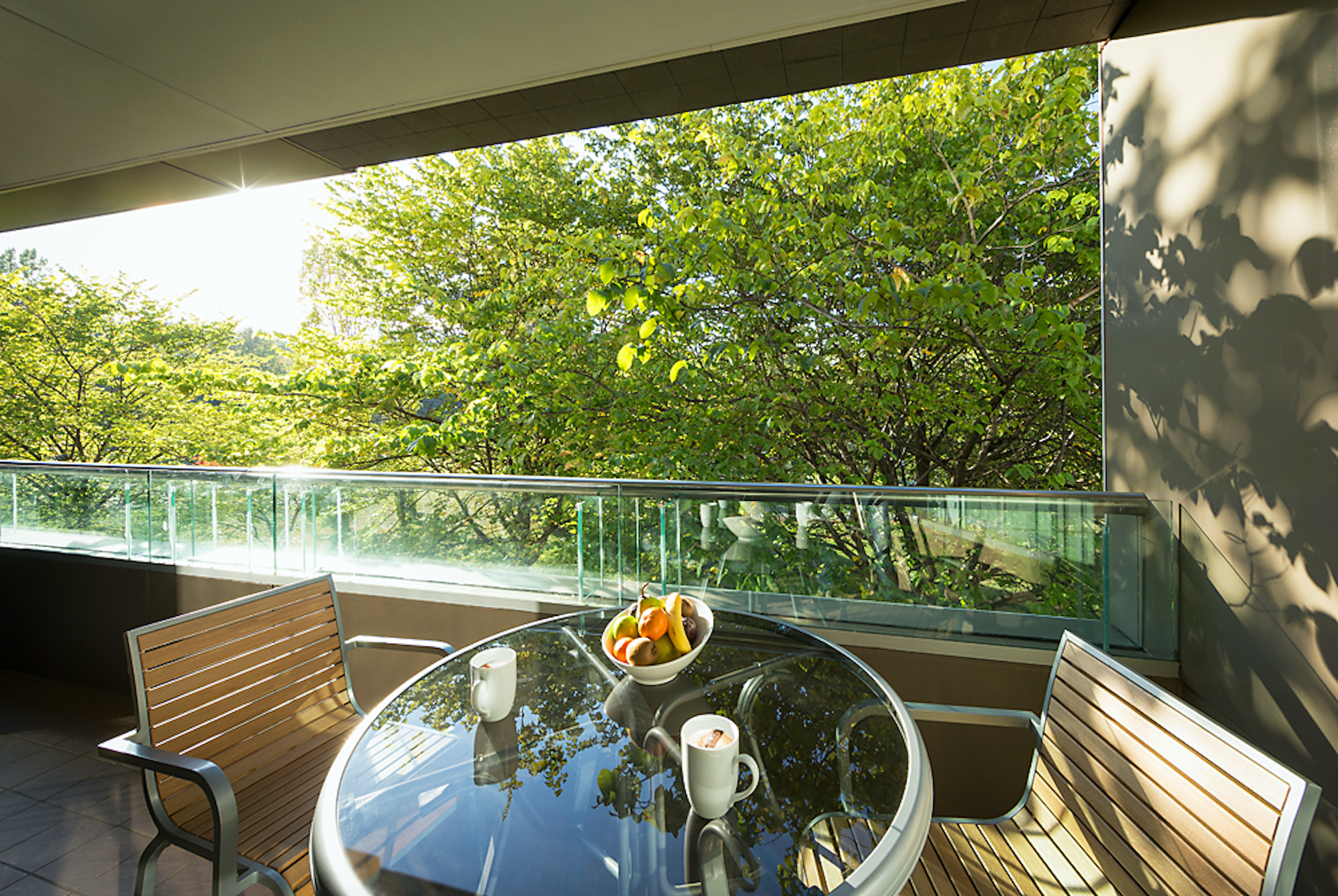 Table on Balcony in Deluxe Suite Accommodation Room | Crowne Plaza Canberra