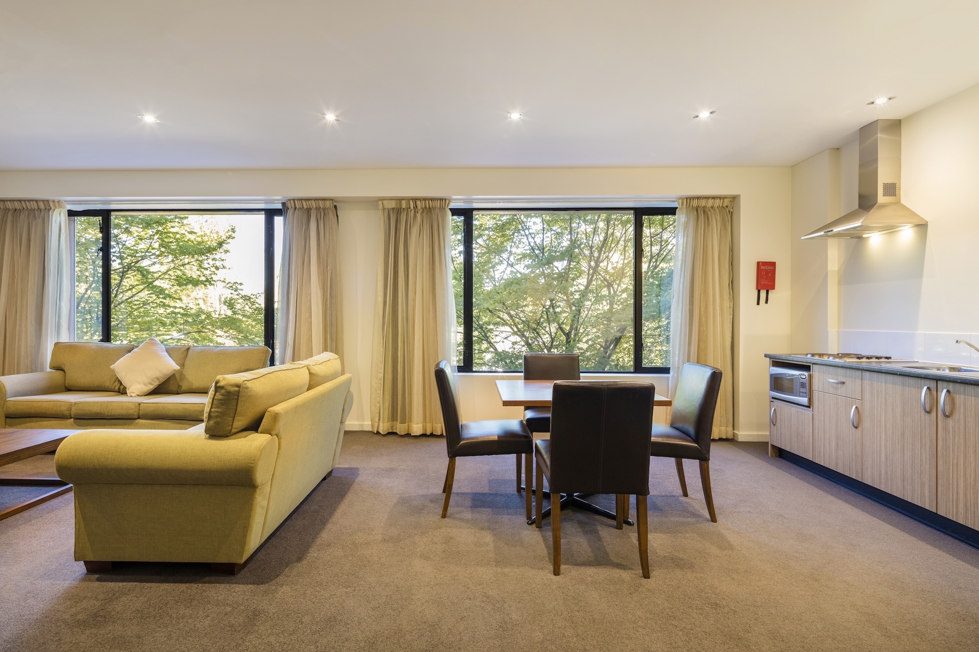 Lounge, table and kitchenette in Deluxe Suite Accommodation Room | Crowne Plaza Canberra