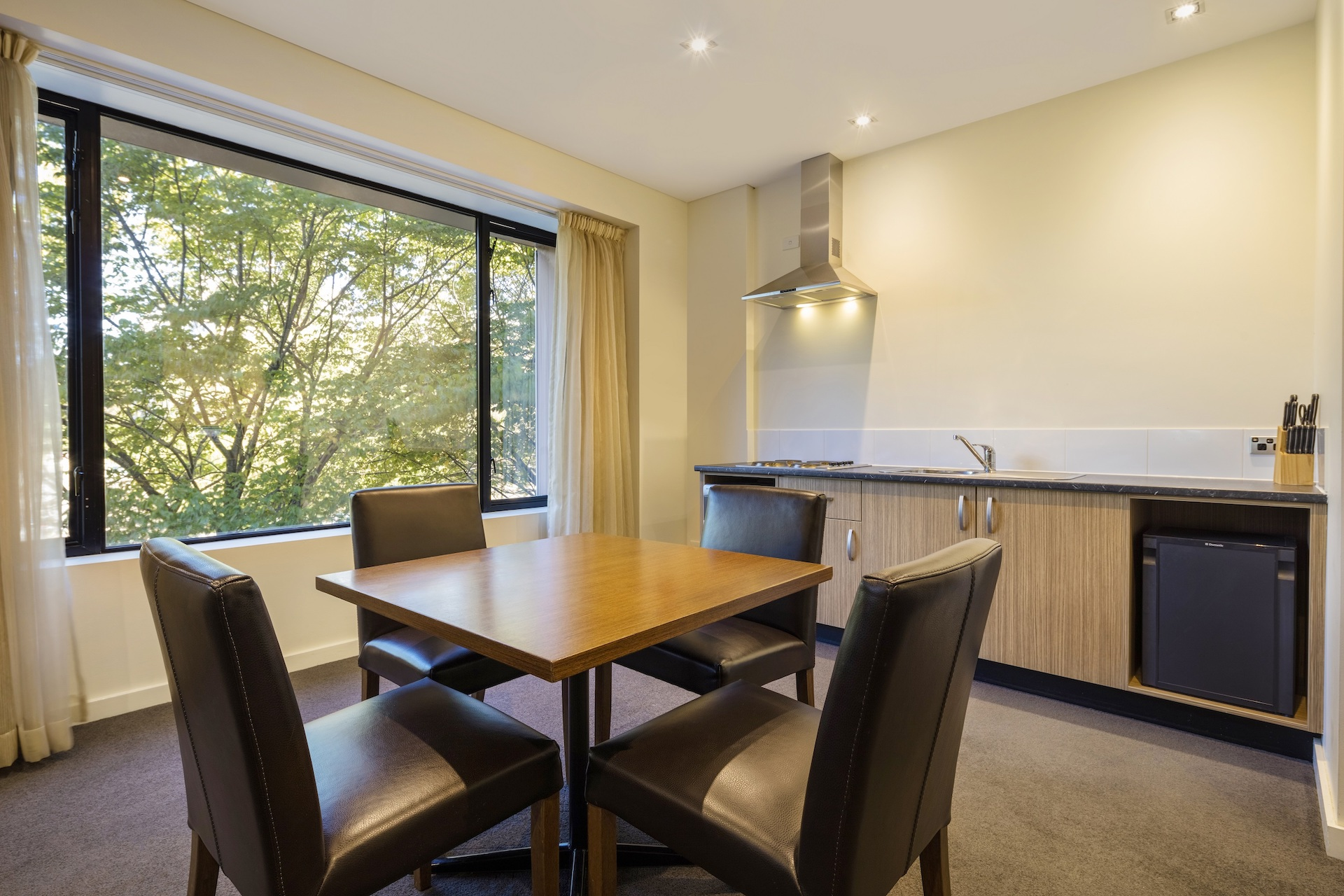 Table and kitchenette in Deluxe Suite Accommodation Room | Crowne Plaza Canberra