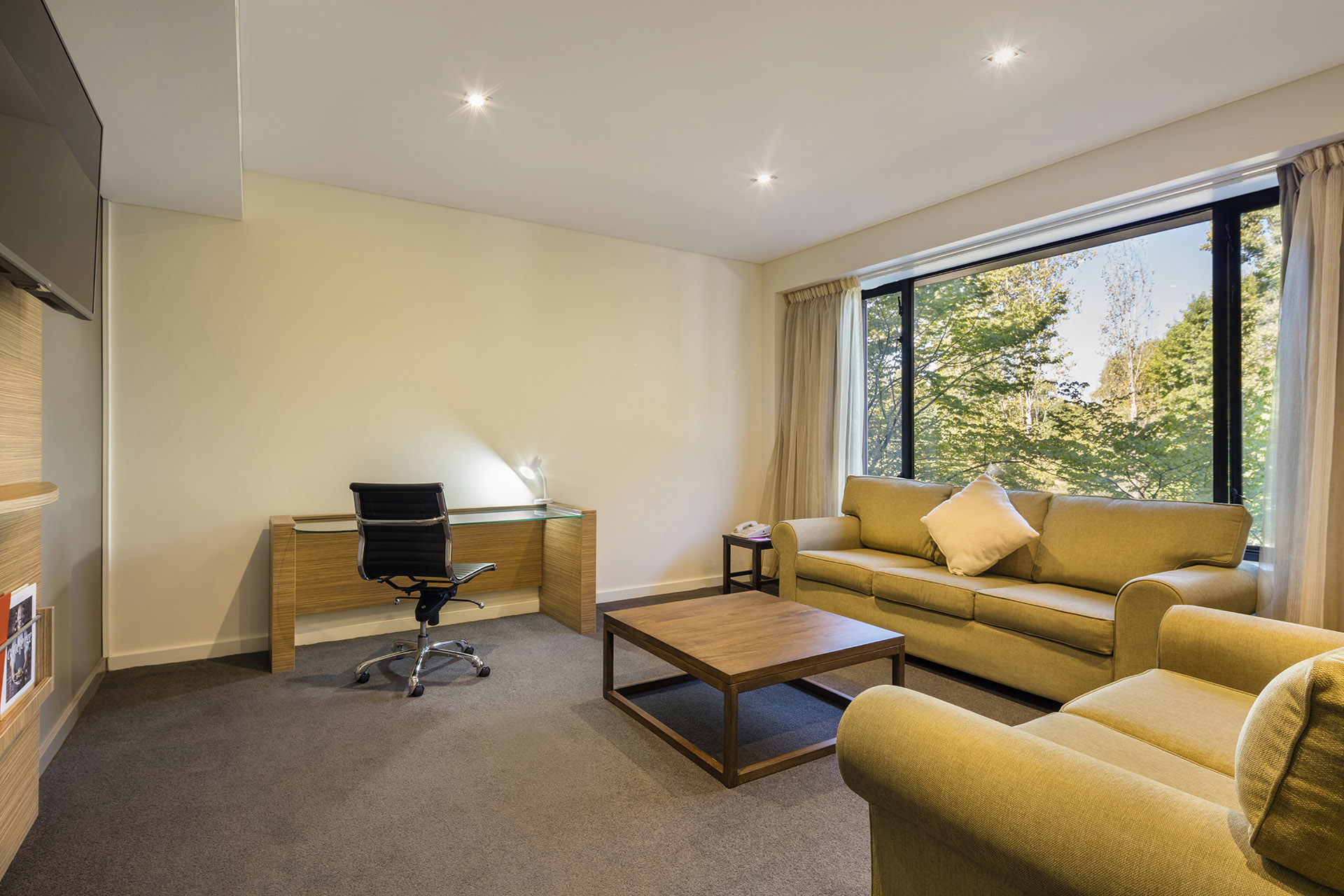 The living area in Crowne Plaza Canberra's Deluxe Suite.